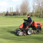 Greenkeeper on grasscutter